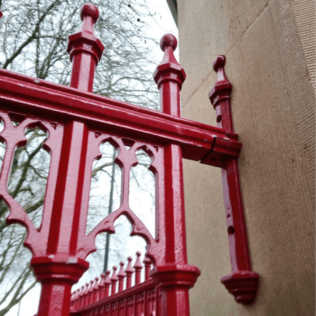Cast iron railings made in Britain to match the original architect designs from Library of Birmingham archives. The colour is called solemn red and was chosen after research into the original colour scheme.